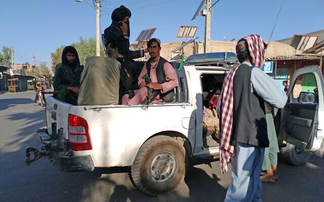 Taliban fighters patrol inside the city of Farah, capital of Farah province southwest of Kabul, Afghanistan, on August 11, 2021. (AP Photo/Mohammad Asif Khan)