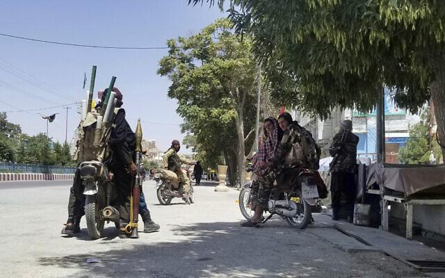 Taliban fighters patrol inside the city of Ghazni, southwest of Kabul, Afghanistan,  on Thursday, August 12, 2021. (AP Photo/Gulabuddin Amiri)