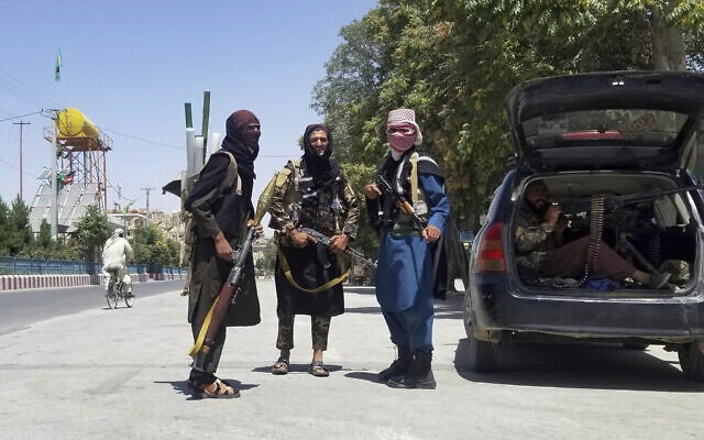 Taliban fighters pose for a photo as they patrol inside the city of Ghazni, southwest of Kabul, Afghanistan, Aug. 12, 2021 (AP Photo/Gulabuddin Amiri)