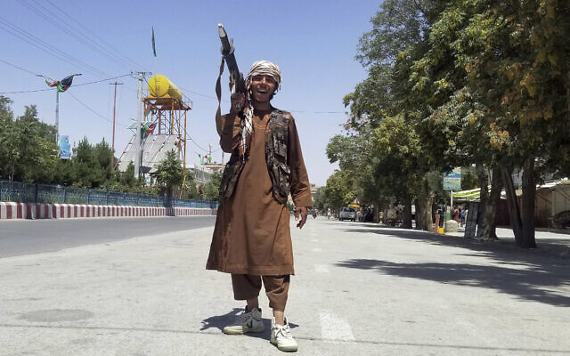 A Taliban fighter poses for a photo as he patrols inside the city of Ghazni, southwest of Kabul, Afghanistan, August 12, 2021. (Gulabuddin Amiri/AP)
