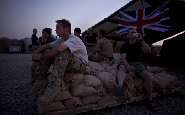 In this August 22, 2011 file photo, British soldier Lance Cpl. Justin Reeve, of Dorset, England, of the Royal Corps of Signals, rests after a day spent establishing coms, at Combat Outpost Ouellette, Helmand province, southern Afghanistan. (AP/Brennan Linsley, file)