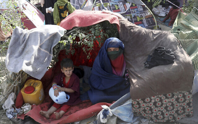 Internally displaced Afghans from northern provinces, who fled their home due to fighting between the Taliban and Afghan security personnel, take refuge in a public park Kabul, Afghanistan, Aug. 13, 2021 (AP Photo/Rahmat Gul)