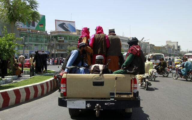 Taliban fighters sit on the back of a vehicle in the city of Herat, west of Kabul, Afghanistan, August 14, 2021, after taking the province from the Afghan government. (AP Photo/Hamed Sarfarazi)