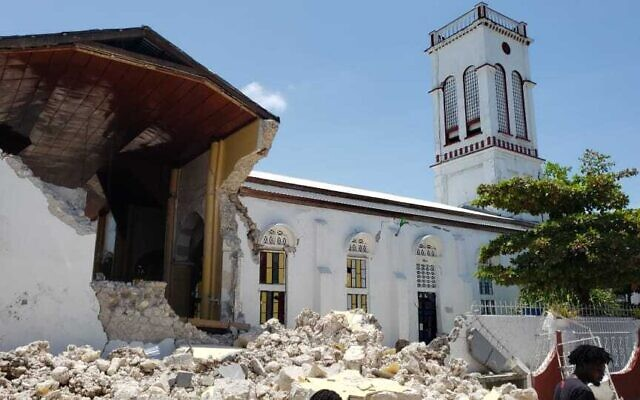 Sacred Heart church is damaged after an earthquake in Les Cayes, Haiti, on Saturday, August 14, 2021. (AP Photo/Delot Jean)