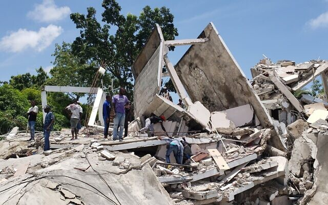 The residence of the Catholic bishop is damaged after an earthquake in Les Cayes, Haiti, on August 14, 2021. (AP Photo/Delot Jean)