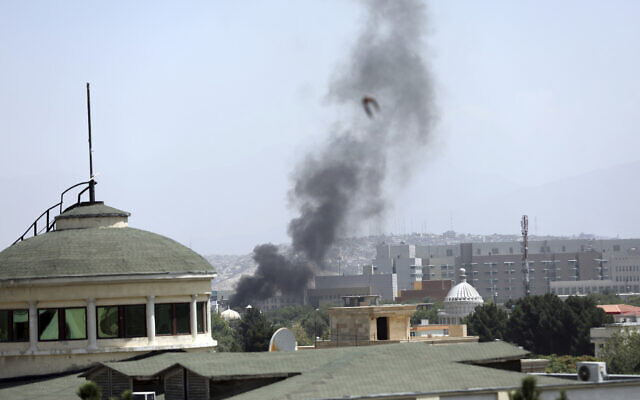 Smoke rises next to the US Embassy in Kabul, Afghanistan, Aug. 15, 2021 (AP Photo/Rahmat Gul)