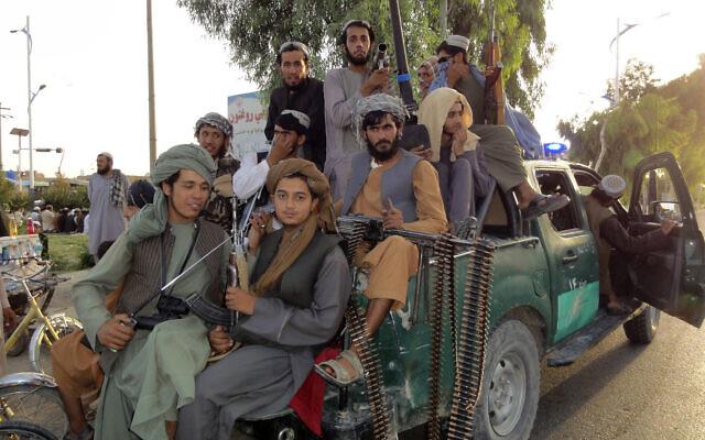 Taliban fighters patrol inside the city of Kandahar province southwest, of Afghanistan, August 15, 2021. (Sidiqullah Khan/AP)