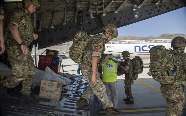 Members of Britain's 16 Air Assault Brigade arrive in Kabul as part of a 600-strong UK force sent to assist with Operation PITTING to rescue British nationals in Afghanistan amidst the worsening security situation there, on August 15, 2021. (Leading Hand Ben Shread/Ministry of Defence via AP)