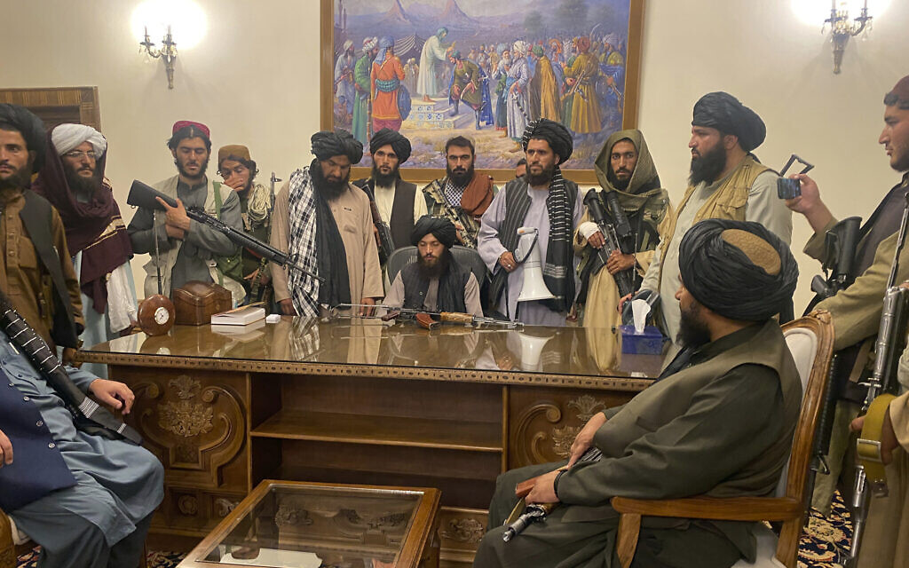 Taliban fighters take control of the Afghan presidential palace after President Ashraf Ghani fled the country, in Kabul, Afghanistan, August 15, 2021. (AP Photo/Zabi Karimi)