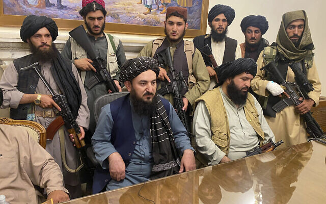 Taliban fighters take control of Afghan presidential palace after the Afghan President Ashraf Ghani fled the country, in Kabul, Afghanistan, Aug. 15, 2021. (AP/Zabi Karimi)