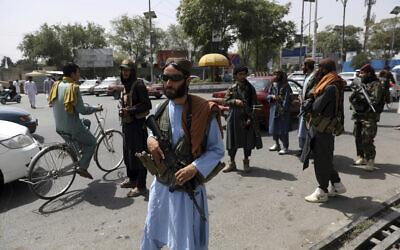 Taliban fighters patrol in the Wazir Akbar Khan neighborhood in the city of Kabul, Afghanistan, August 18, 2021. (AP Photo/Rahmat Gul)