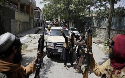 Taliban fighters patrol in Kabul, Afghanistan, on August 19, 2021. (AP/Rahmat Gul)