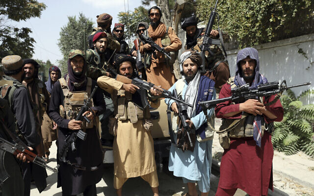 Taliban fighters pose for a photograph in Kabul, Afghanistan, on Thursday, August 19, 2021. (AP Photo/Rahmat Gul)