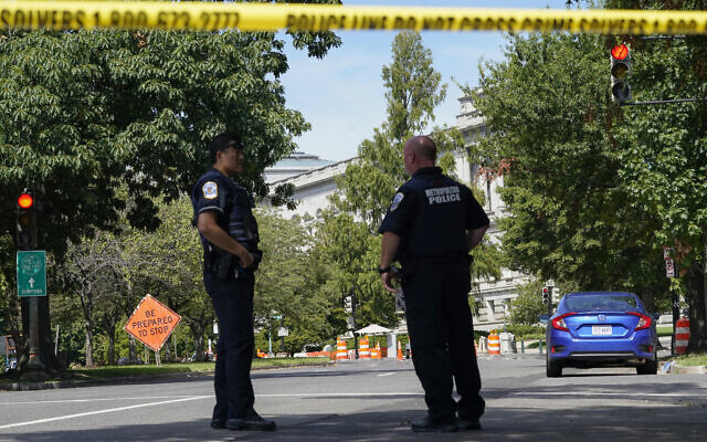 Law enforcement officials surround an area of Pennsylvania Avenue area near the US Capitol and a Library of Congress building in Washington, on August 19, 2021, as they investigate a report of a pickup truck containing an explosive device. (AP Photo/Alex Brandon)