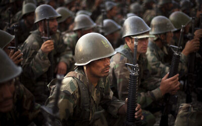 Afghan National Army recruits listen to the explanations of their instructor during a training session at the Kabul Military Training Center in Afghanistan, July 19, 2009. (AP Photo/Emilio Morenatti)