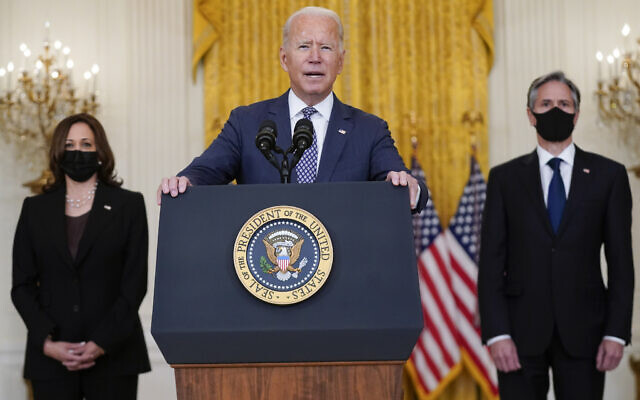 US President Joe Biden speaks about the evacuation of American citizens, their families, SIV applicants and vulnerable Afghans in the East Room of the White House, on August 20, 2021, in Washington, DC. Vice President Kamala Harris, left, and Secretary of State Antony Blinken listen. (AP Photo/Manuel Balce Ceneta)