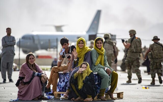 In this image provided by the US Marines, evacuee children wait for the next flight after being manifested at Hamid Karzai International Airport, in Kabul, Afghanistan, on Thursday, August 19, 2021. (1st Lt. Mark Andries/U.S. Marine Corps via AP)