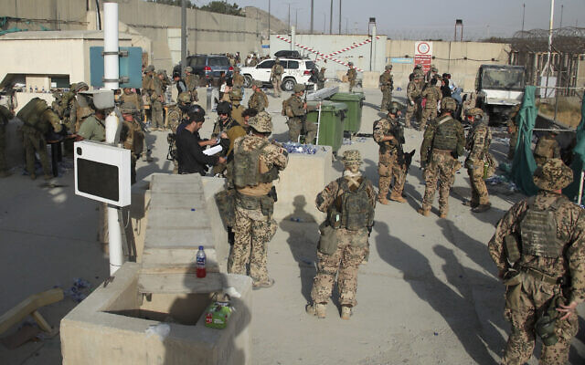 In this photo provided by the Ministry of Defence, members of the British and US military engage in the evacuation of people out of Kabul, Afghanistan, on August 20, 2021. (Ministry of Defence via AP)