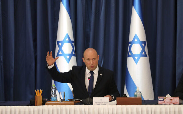 Prime Minister Naftali Bennett chairs the weekly cabinet meeting, in Jerusalem on Aug. 22, 2021. (Gil Cohen-Magen/POOL via AP)