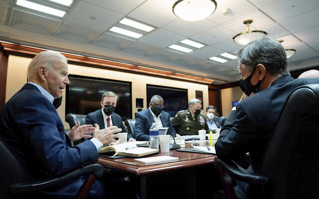 In this image released by The White House, US President Joe Biden speaks with his national security team during a briefing on the situation in Afghanistan on Aug. 22, 2021, in the White House Situation Room in Washington. (Erin Scott/The White House via AP)