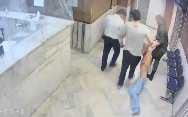 """In this undated frame grab taken from video shared with The Associated Press by a self-identified hacker group called """"The Justice of Ali,"""" guards drag an emaciated prisoner, at Evin prison in Tehran, Iran. (The Justice of Ali via AP)"""
