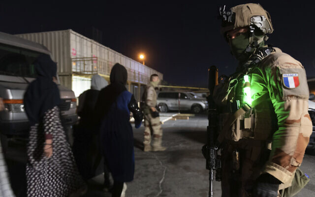 This photo provided on August 24, 2021, by the French Army shows a French soldier at Kabul airport, Afghanistan. (Etat-Major des Armees via AP)