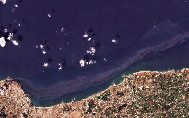 In this satellite photo from Planet Labs Inc., an oil spill is seen stretching off the coast near Baniyas, Syria, August 24, 2021. (Planet Labs Inc. via AP)