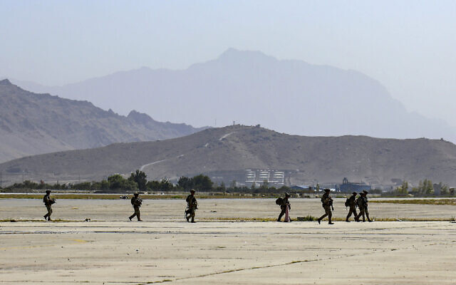 Paratroopers assigned to the 1st Brigade Combat Team, 82nd Airborne Division help facilitate the safe evacuation of U.S. citizens, Special Immigrant Visa applicants, and other at-risk Afghans out of Afghanistan, at Hamid Karzai International Airport, Kabul, Afghanistan, Wednesday, Aug. 25, 2021. (Sgt. Jillian G. Hix/U.S. Army via AP)