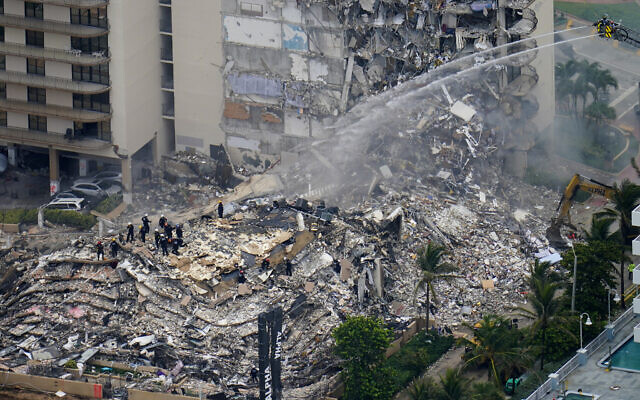 Rescue workers work in the rubble at the Champlain Towers South Condo in Surfside, Florida, June 25, 2021. (AP Photo/Gerald Herbert, File)