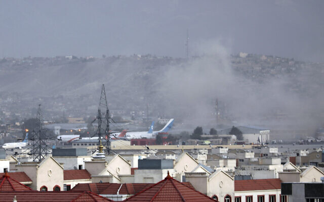Smoke rises from an explosion outside the airport in Kabul, Afghanistan, August 26, 2021. (AP Photo/Wali Sabawoon)