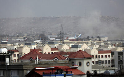 Smoke rises from a deadly explosion outside the airport in Kabul, Afghanistan on Aug. 26, 2021. (AP/Wali Sabawoon)