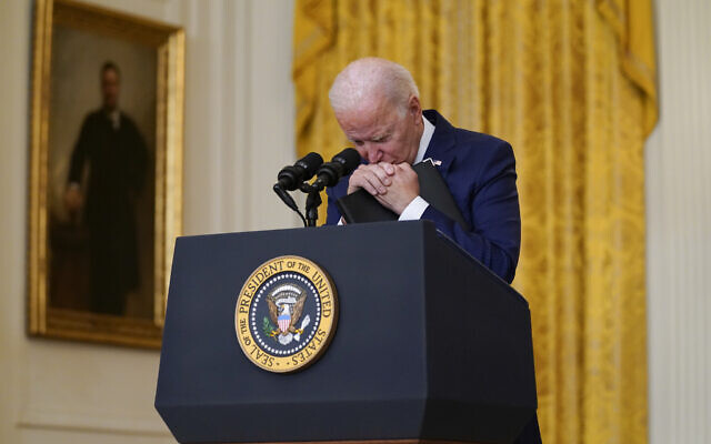 US President Joe Biden pauses as he speaks about the bombings at the Kabul airport that killed at least 13 US service members, from the East Room of the White House, August 26, 2021, in Washington. (AP/Evan Vucci)