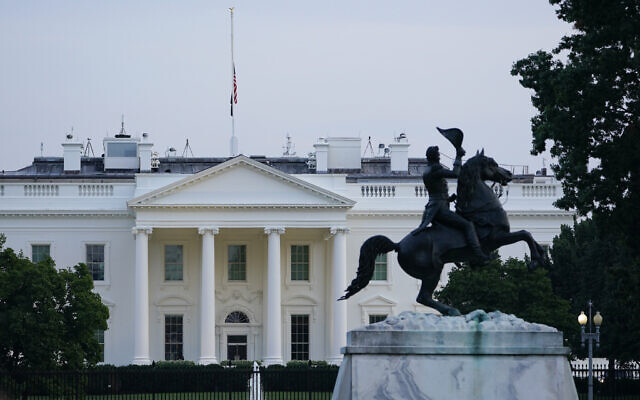 The American flag on the roof of the White House flies at half staff in Washington, Thursday, Aug. 26, 2021, in honor of US service members and other victims killed in the terrorist attack in Kabul, Afghanistan. (AP Photo/Susan Walsh)