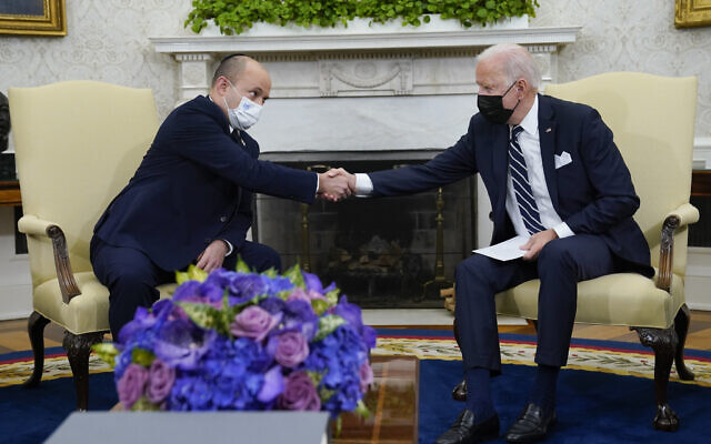 US President Joe Biden shakes hands with Israeli Prime Minister Naftali Bennett as they meet in the Oval Office of the White House, Friday, Aug. 27, 2021, in Washington. (AP Photo/Evan Vucci)