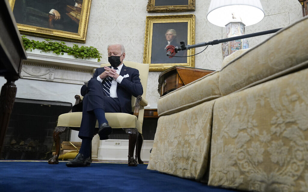In this August 27, 2021 photo, US President Joe Biden listens as he meets with Israeli Prime Minister Naftali Bennett in the Oval Office of the White House in Washington. (AP/Evan Vucci)