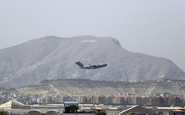 US military aircraft takes off at the Hamid Karzai International Airport in Kabul, Afghanistan, on August 28, 2021. (AP Photo/Wali Sabawoon)