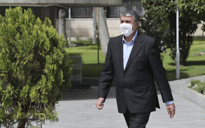 In this photo released by the official website of the office of the Iranian Presidency, then-Minister of Road and Urbanization Mohammad Eslami, walks in the presidency compound, April 7, 2021, in Tehran, Iran. (Iranian Presidency Office via AP)
