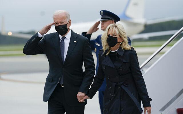 US President Joe Biden returns a salute as he and first lady Jill Biden arrive at Dover Air Force Base, Delaware, August 29, 2021. (Manuel Balce Ceneta/AP)