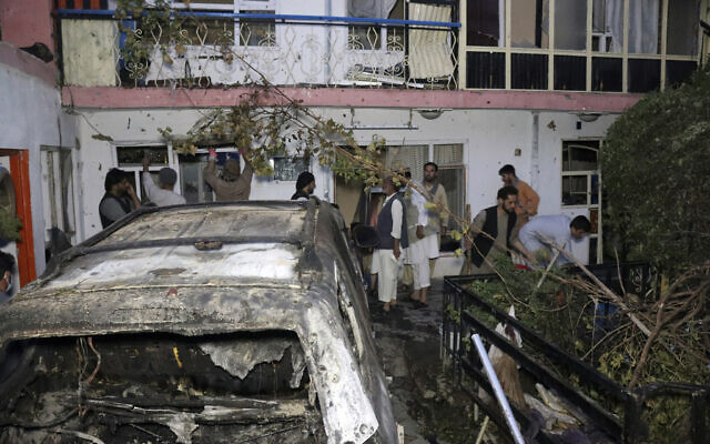 Afghan people are seen inside a house after US drone strike in Kabul, Afghanistan, on August 29, 2021. (AP Photo/ Khwaja Tawfiq Sediqi)