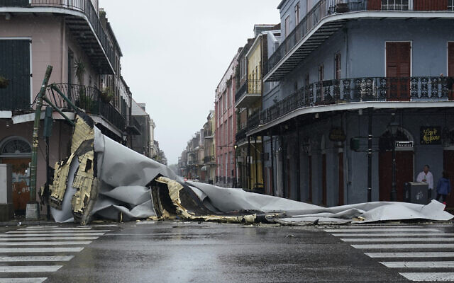 A section of roof that was blown off of a building in the French Quarter by Hurricane Ida winds blocks an intersection, August 29, 2021, in New Orleans. (AP Photo/Eric Gay)