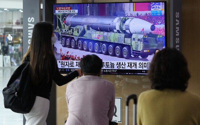 People watch a TV screen showing a file image of a North Korean missile in a military parade during a news program at the Seoul Railway Station in Seoul, South Korea, Monday, August 30, 2021. (AP Photo/Ahn Young-joon)
