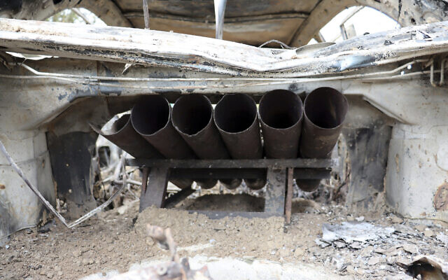 Rocket launcher tubes are seen inside a destroyed vehicle in Kabul, Afghanistan, August 30, 2021. (AP Photo/Khwaja Tawfiq Sediqi)