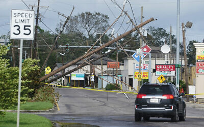 Traffic diverts around downed power lines August 30, 2021, in Metairie, Louisiana. (AP Photo/Steve Helber)