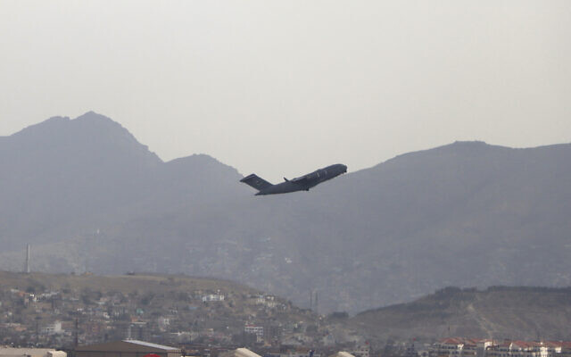 A US military aircraft takes off from the Hamid Karzai International Airport in Kabul, Afghanistan, Monday, Aug. 30, 2021. (AP Photo/Wali Sabawoon)