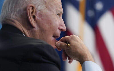US President Joe Biden listens during a virtual meeting with FEMA Administrator Deanne Criswell and governors and mayors of areas impacted by Hurricane Ida, in the South Court Auditorium on the White House campus, August 30, 2021, in Washington. (AP Photo/Evan Vucci)