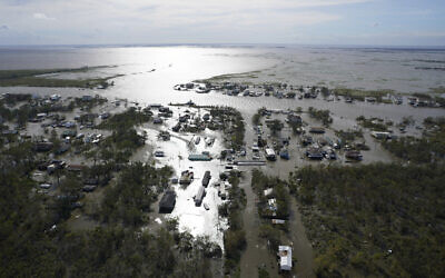 Homes are flooded in the aftermath of Hurricane Ida, August 30, 2021, in Lafitte, Louisiana. (AP Photo/David J. Phillip)