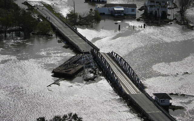A barge damages a bridge that divides Lafitte and Jean Lafitte, in the aftermath of Hurricane Ida, August 30, 2021, in Louisiana. (AP Photo/David J. Phillip)