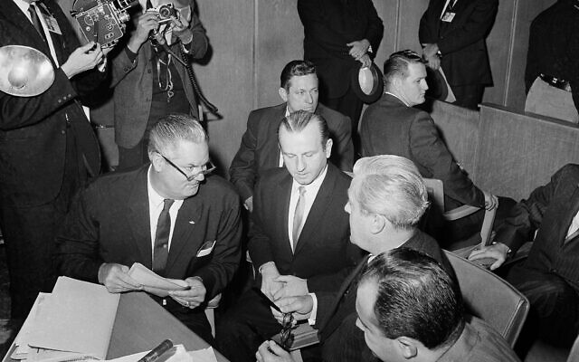 Jack Ruby, seated, second from left, with his attorneys, including Sam Houston Clinton, at his sanity hearing in Dallas, Texas, October 15, 1965. (AP Photo/Dave Taylor)