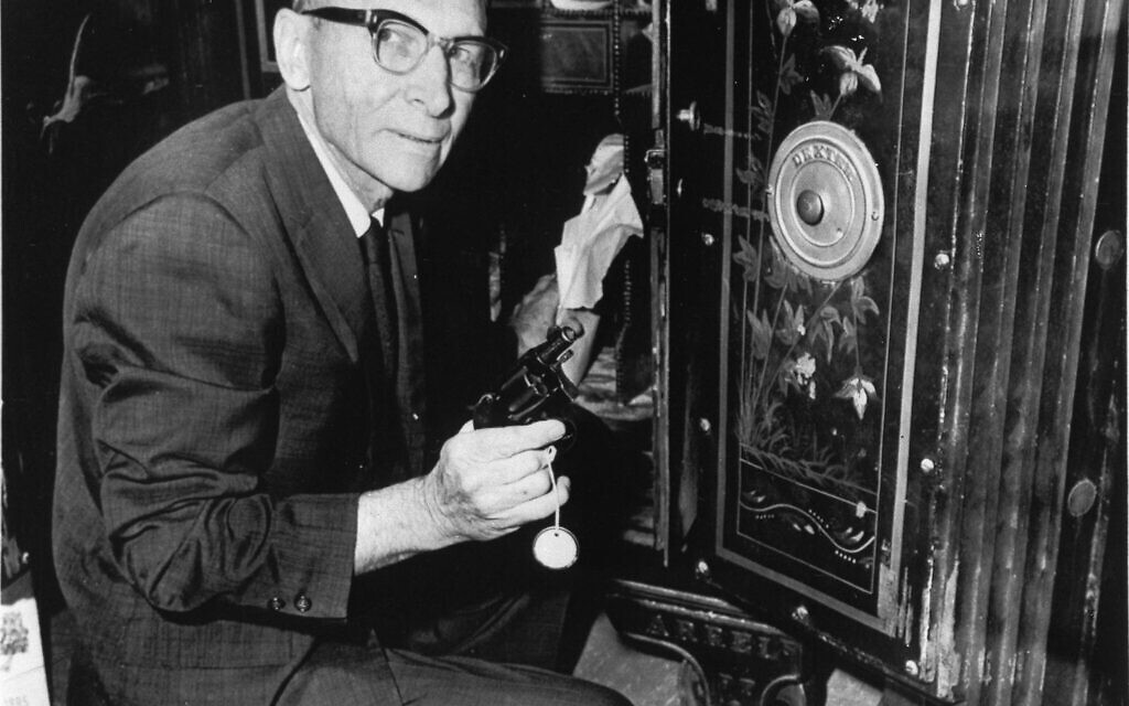 Clerk Glenn Haynes of the Texas Court of Criminal Appeals in Austin, June 24, 1966, removes from a safe the gun which Jack Ruby used to kill accused assassin of John F. Kennedy. (AP Photo/Ted Powers)