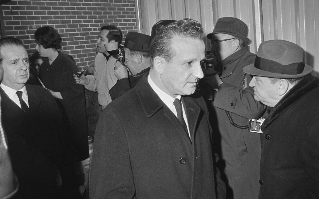 Two brothers of Jack Ruby, slayer of Lee Harvey Oswald, Sam, left, and Earl, right, leave a Chicago funeral home following services for Jack on January 6, 1967. (AP Photo/Charles Knoblock)